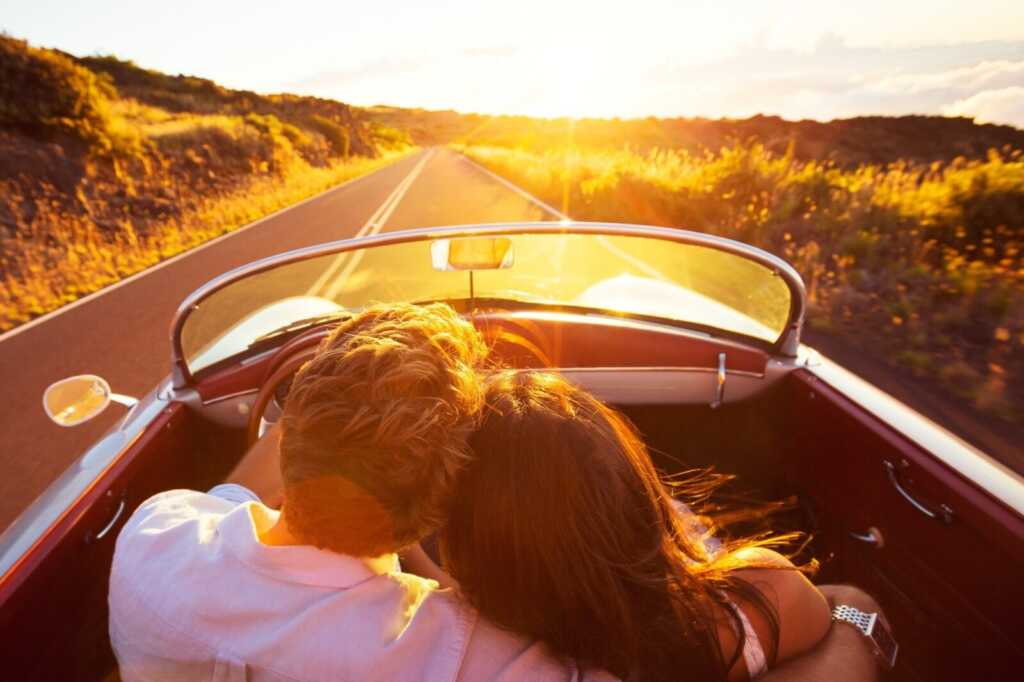 Driving,into,the,sunset.,romantic,young,couple,enjoying,sunset,drive